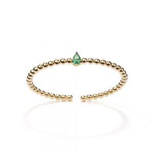 Bracelete em ouro amarelo com esmeralda.