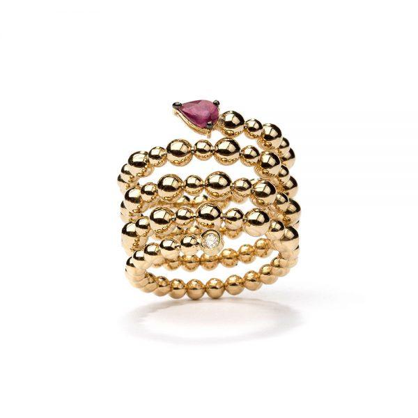 Anel em ouro amarelo com rubi e diamante.